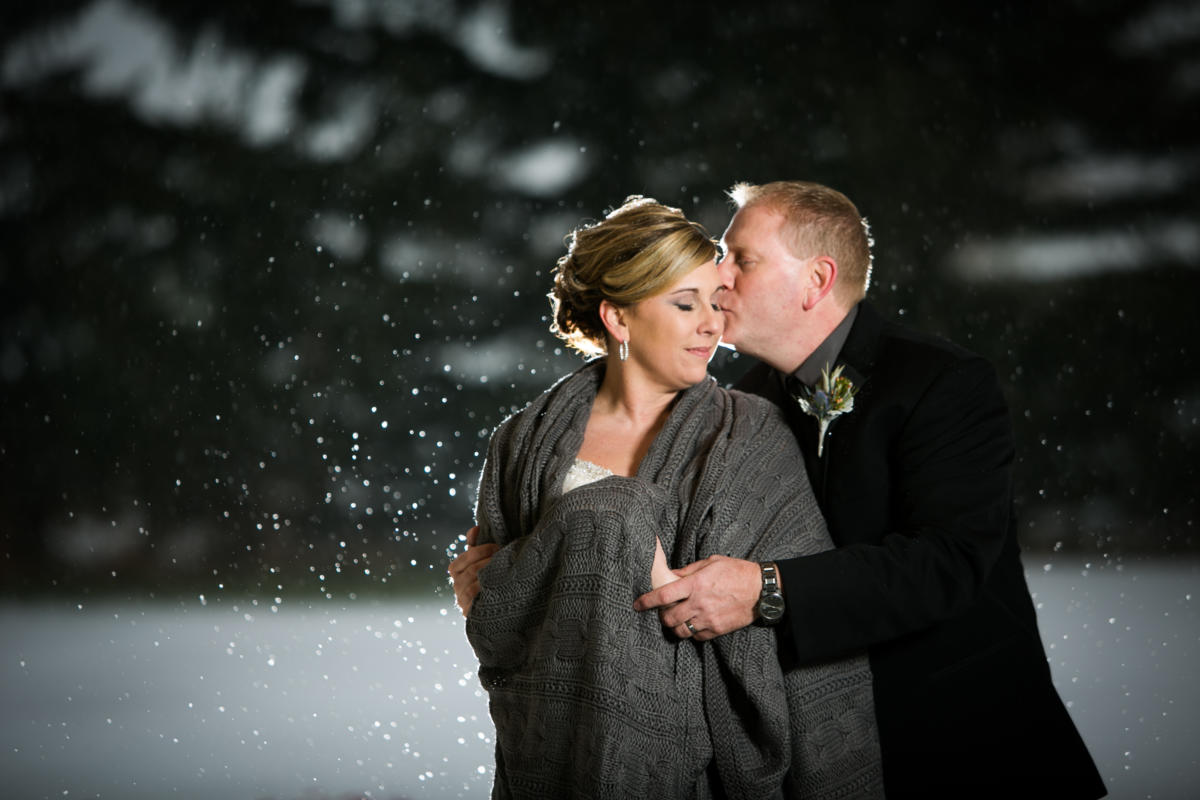 snow lit up from flash on wedding day